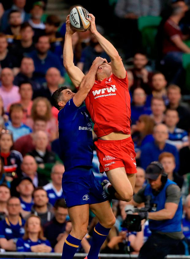 Leinster's Rob Kearney (left) and Scarlet's Tom Prydie in action. Photo credit: Donall Farmer/PA Wire