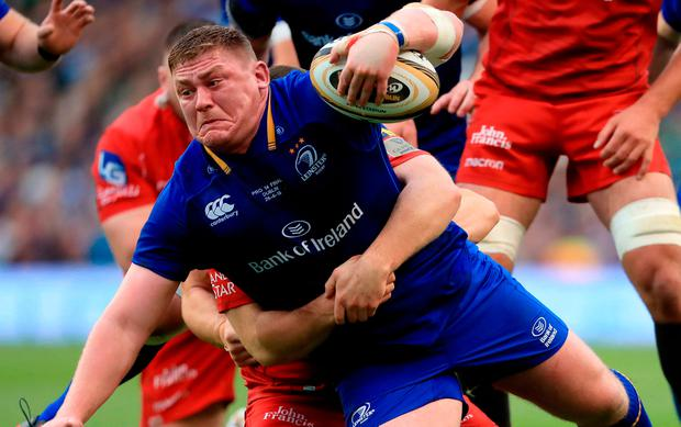 Leinster's Tadhg Furlong is tackled by Scarlet's Ken Owens. Photo credit: Donall Farmer/PA Wire