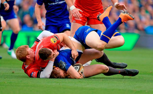 Leinster's Garry Ringrose (right) and Scarlets' Gareth Davies and Rhys Patchell in action. Photo credit: Donall Farmer/PA Wire