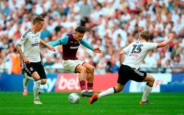 Fulham's Tim Ream (right) challenges Aston Villa's Jack Grealish (centre). Photo credit: Nigel French/PA Wire