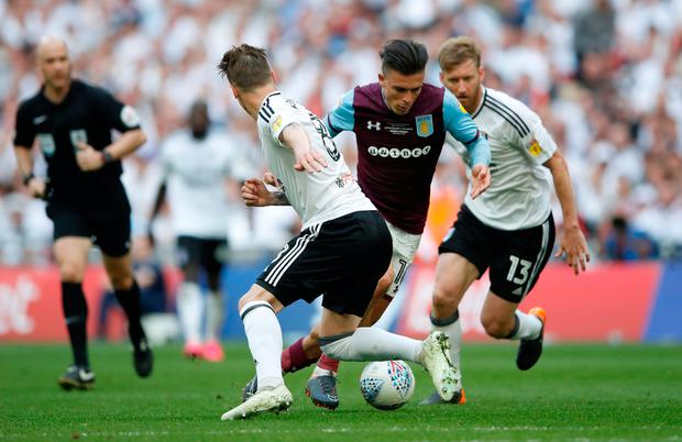 Aston Villa's Jack Grealish in action with Fulham's Stefan Johansen. Photo: Reuters/Carl Recine