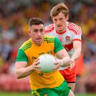 Patrick McBrearty of Donegal in action against Brendan Rogers of Derry. Photo: Oliver McVeigh/Sportsfile