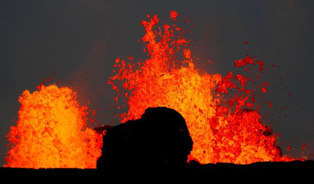Lava from the Kilauea volcano shoots out of a fissure near Pahoa, Hawaii. Photo: REUTERS/Marco Garcia