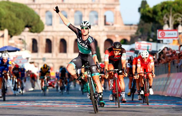 WINNER: Ireland's Sam Bennett celebrates as he crosses the finish line to take the last stage of the Giro d'Italia in Rome. Photo: REUTERS/Alessandro Garofalo