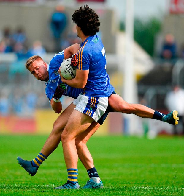 Ross O'Brien of Wicklow is tackled by Jonny Cooper of Dublin. Photo: Ramsey Cardy/Sportsfile