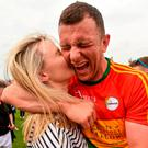 Carlow's Darragh Foley celebrates his team's victory with girlfriend Shona Delaney. Photo: Matt Browne/Sportsfile