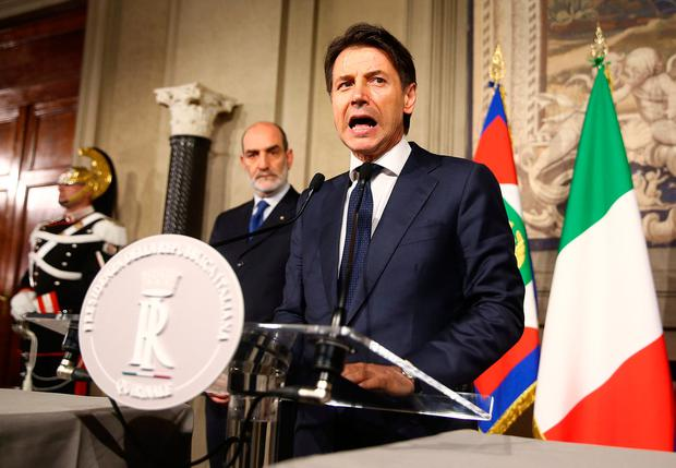 Italy's Prime Minister-designate Giuseppe Conte speaks to the media after a meeting with the Italian President Sergio Mattarella at the Quirinal Palace in Rome, Italy. Photo: REUTERS/Alessandro Bianchi