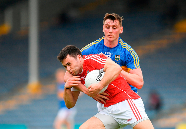 Stephen Cronin of Cork in action against Conor Sweeney of Tipperary. Photo by Eóin Noonan/Sportsfile