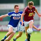 Luke Loughlin of Westmeath in action against Paul Kingston of Laois. Photo: Matt Browne/Sportsfile