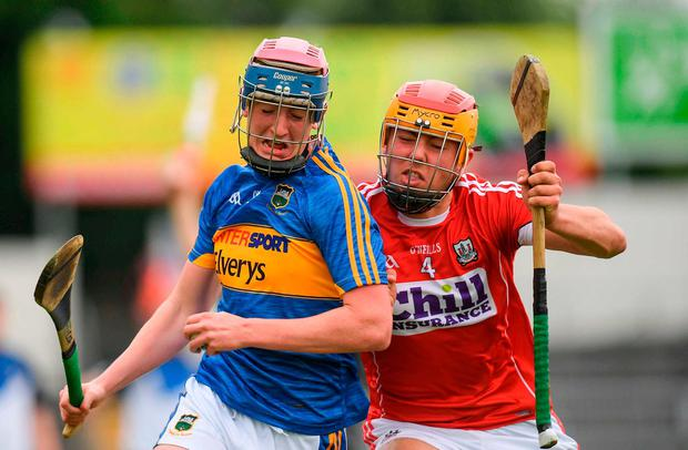 Tipperary's Cian O'Farrell attempts to get away from Cork's Niall O'Riordan during their Munster MHC clash in Thurles. Photo: Eóin Noonan/Sportsfile