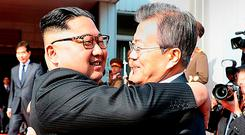 Mr Kim and Mr Moon embrace. Photo: South Korean Presidential Blue House via Getty Images