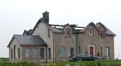 The family home that was burned out after it was struck by lightning. Picture: Provision