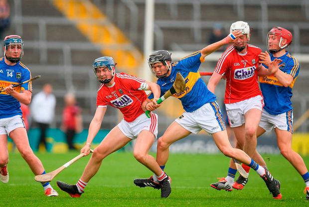Olan Broderick of Cork in action against Max Hackett of Tipperary. Photo by Eóin Noonan/Sportsfile