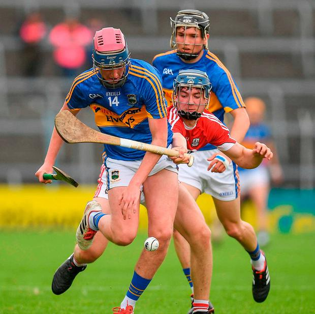 Cian O'Farrell of Tipperary in action against Paul Cooney of Cork. Photo: Eóin Noonan/Sportsfile