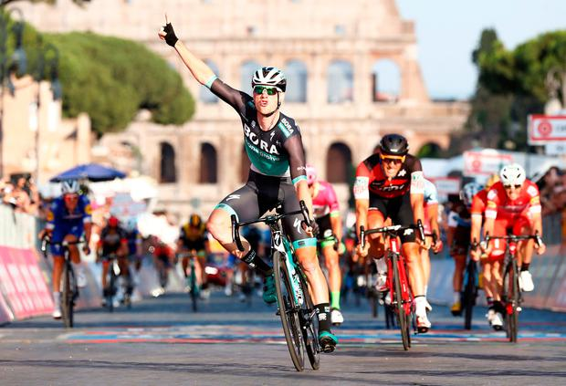 Sam Bennett celebrates as he crosses the finish line to win the last stage of the Giro d'Italia. Photo: Reuters/Alessandro Garofalo