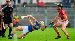 Brendan Maher of Tipperary tries to clear his lines under pressure from Cork's Mark Ellis during their Munster SHC clash. Photo: Daire Brennan/Sportsfile