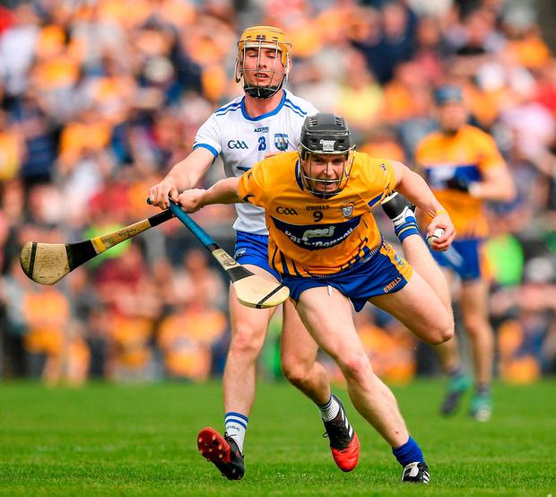 Tony Kelly of Clare in action against Tommy Ryan of Waterford. Photo: Ray McManus/Sportsfile
