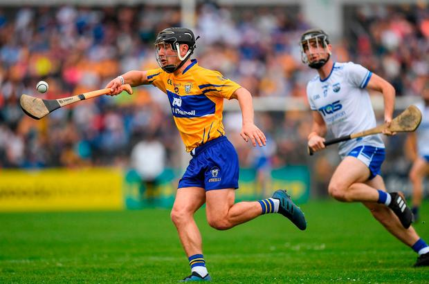 David Reidy of Clare in action against Colm Roche of Waterford. Photo: Ray McManus/Sportsfile