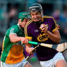 Jack O'Connor of Wexford in action against David King of Offaly. Photo: Matt Browne/Sportsfile