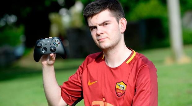 Conran 'Rannerz' Tobin gets paid to play video games professionally. Photo: Justin Farrelly