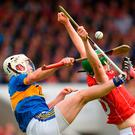 Cork's Seamus Harnedy in action against Tipperary's Sean O'Brien in Thurles. Photo: Eóin Noonan/Sportsfile