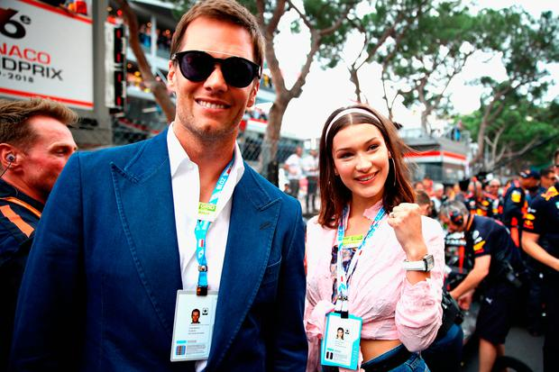 NFL star Tom Brady and supermodel Bella Hadid pose for a photo next to the Red Bull Racing team on the grid before the Monaco Formula One Grand Prix at Circuit de Monaco on May 27, 2018 in Monte-Carlo, Monaco. (Photo by Mark Thompson/Getty Images)