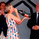 Princess Charlene of Monaco drinks the winner champagne on the podium during the Monaco Formula One Grand Prix at Circuit de Monaco on May 27, 2018 in Monte-Carlo, Monaco. (Photo by Mark Thompson/Getty Images)