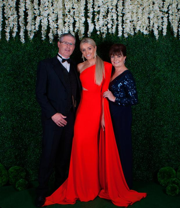 Louise Cooney, centre, with her parents Tony, left, and Grainne, right, at the Limerick 40 Under 40 Awards. Picture: Baker Photography