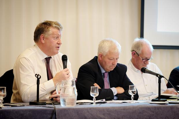 Arrabawn CEO Conor Ryan addressing the co-op's AGM, flanked by Chairman Sean Monahan and Secretary Jerry Ryan.