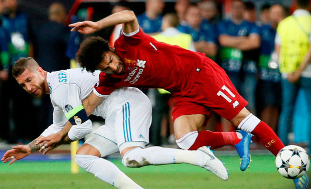 CLASH: Sergio Ramos hauls down Mohamed Salah during last Saturday's Champions League final. Photo: Reuters