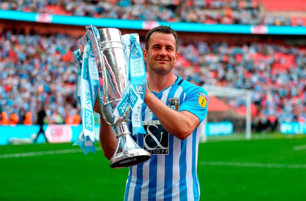 GOING UP: Coventry City's Michael Doyle celebrates with the trophy after yesterday's League Two Play-off Final win over Exeter City at Wembley. Photo: PA Wire