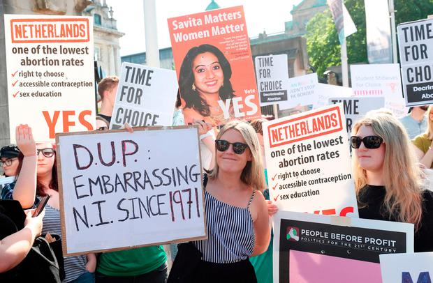 People attend a protest calling for the provision of abortion in the North at Belfast City Hall yesterday. Photo: Niall Carson