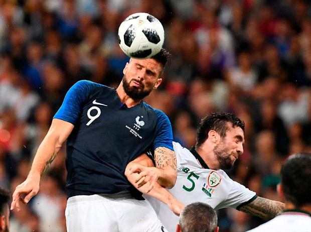 Olivier Giroud rises above Shane Duffy in the process of opening the scoring for France last night. Photo: Franck Fife/AFP/Getty