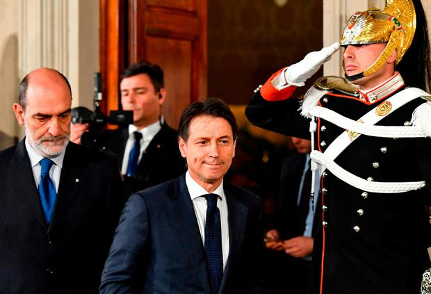 Italy's former prime minister candidate Giuseppe Conte (centre) leaves after a meeting with President Sergio Mattarella. Photo: Vincenzo Pinto/AFP/Getty Images