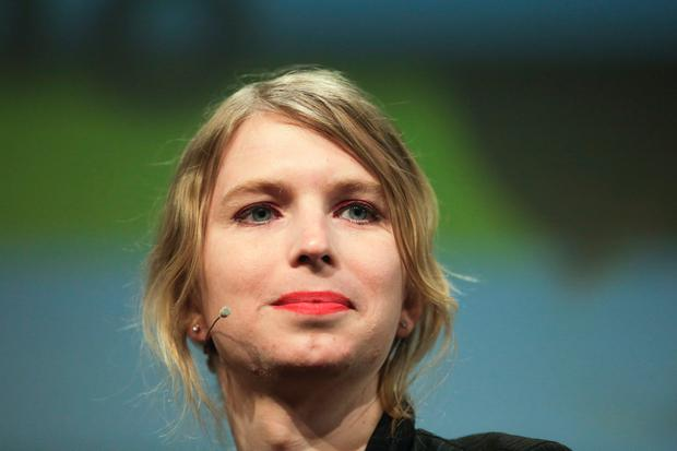Chelsea Manning attends a discussion at the media convention