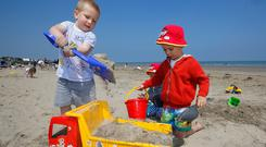 Patrick Tyrell (3) left, from Finglas and Nikodem Gajdosz, from Santry play in the sand at Portmarnock strand. Picture credit; Damien Eagers