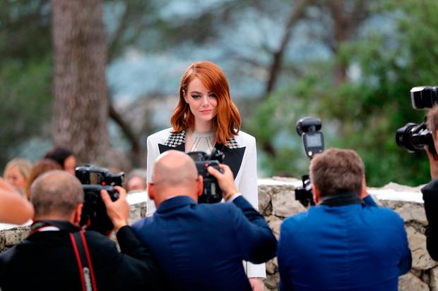 Actress Emma Stone poses for photographers during the Louis Vuitton Cruise 2019 collection fashion show at Maeght foundation in Saint-Paul-de-Vence, southeastern France, on May 28, 2018. / AFP PHOTO / VALERY HACHEVALERY HACHE/AFP/Getty Images