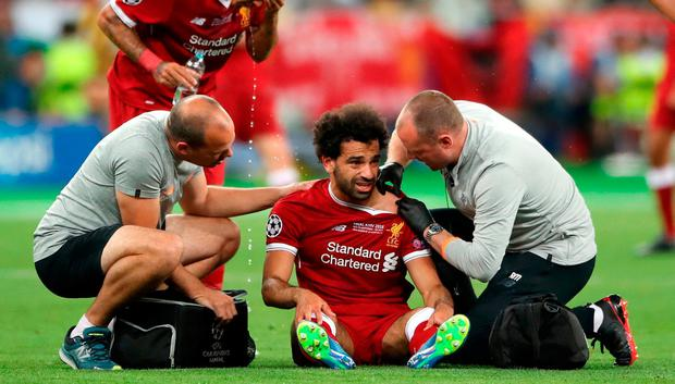 Liverpool's Mohamed Salah reacts after picking up an injury during the UEFA Champions League Final