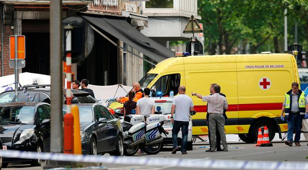 An ambulance car is seen on the scene of a shooting in Liege, Belgium. Photo: REUTERS/Francois Lenoir