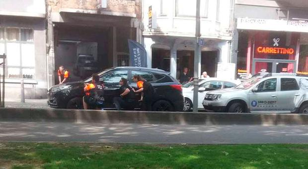 Police officers are seen on the scene of a shooting in Liege, Belgium, May 29, 2018 in this picture obtained from social media. MICHEL WILMET/via REUTERS