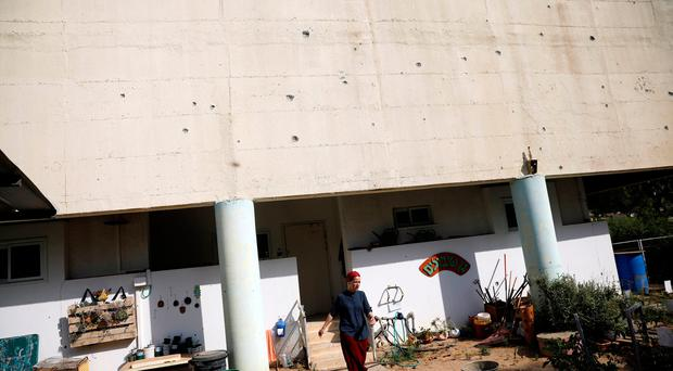Three Israeli soldiers injured as dozens of mortars and rockets fired from Gaza