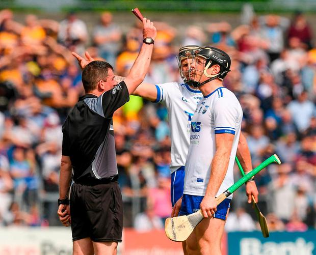 Referee Paud O'Dwyer issues a redcard to Kevin Moran of Waterford, right, during last weekends Championship match against Clare. Photo: Ray McManus/Sportsfile