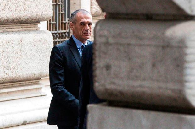Designated Italian Prime Minister Carlo Cottarelli leaves the Lower House in Rome, Tuesday, May 29, 2018. Cottarelli is due to submit his list of ministers to President Sergio Mattarella on Tuesday, and would be charged with leading the country through a period of uncertainty. Photo: Angelo Carconi/ANSA via AP