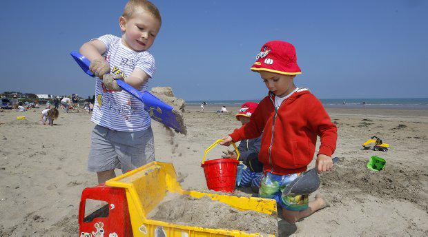 Patrick Tyrell, 3, left, from Finglas and Nikodem Gajdosz, from Santry play in the sand at Portmarnock strand. Picture credit; Damien Eagers