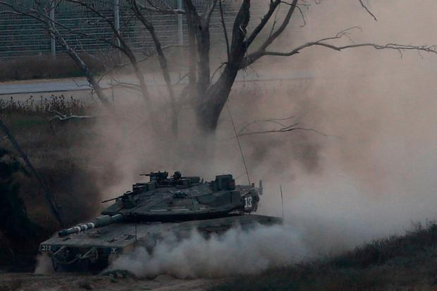 An Israeli tank drives along the border with the Gaza strip (AP Photo/Ariel Schalit)