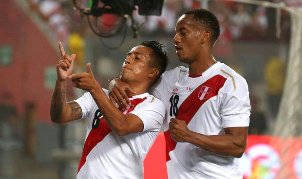 Peru's Christian Cueva, left, celebrates with his teammate Andre Carrillo after scoring against Scotland during a friendly soccer match in Lima, Peru, Tuesday, May 29, 2018. (AP Photo/Martin Mejia)