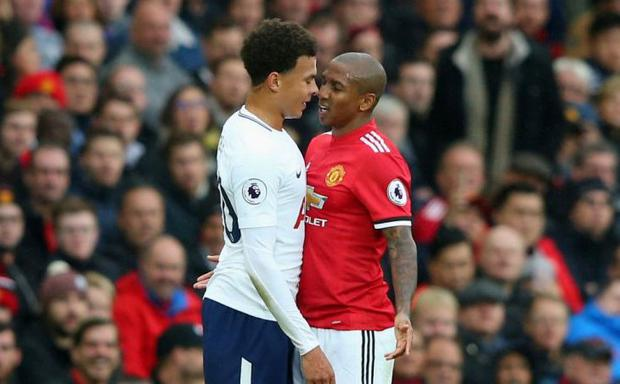Alli and Young shared words during Tottenham's 1-0 defeat to Manchester United in October CREDIT: GETTY IMAGES