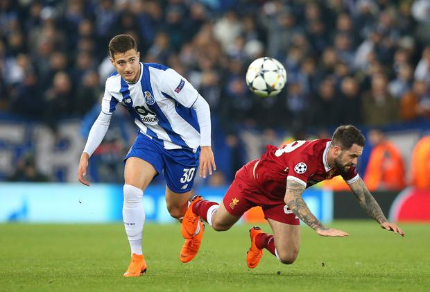 Diogo Dalot in action against Liverpool