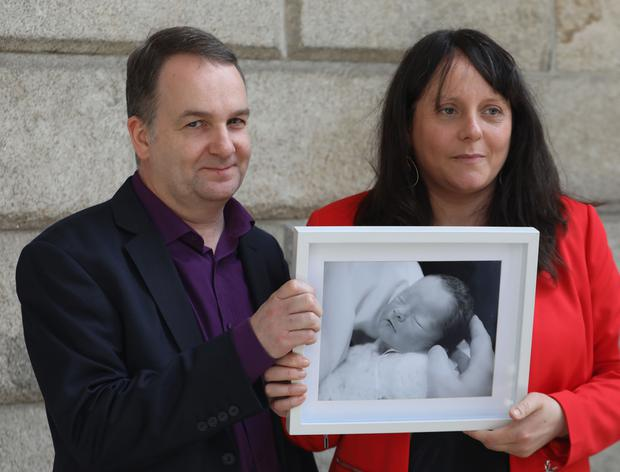 Tracey Jones Furey and Eamonn Furey pictured holding a picture of their daughter, Aisling Photo: Collins Courts