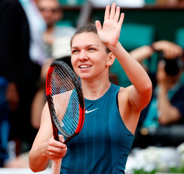 Romania's Simona Halep celebrates after winning her first round match against Alison Riske of the U.S. Photo: Reuters